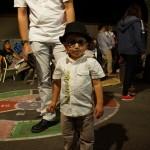 Enfant avec chapeau et lunette noire